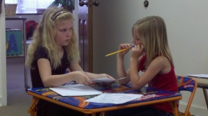 older girl tutoring younger
